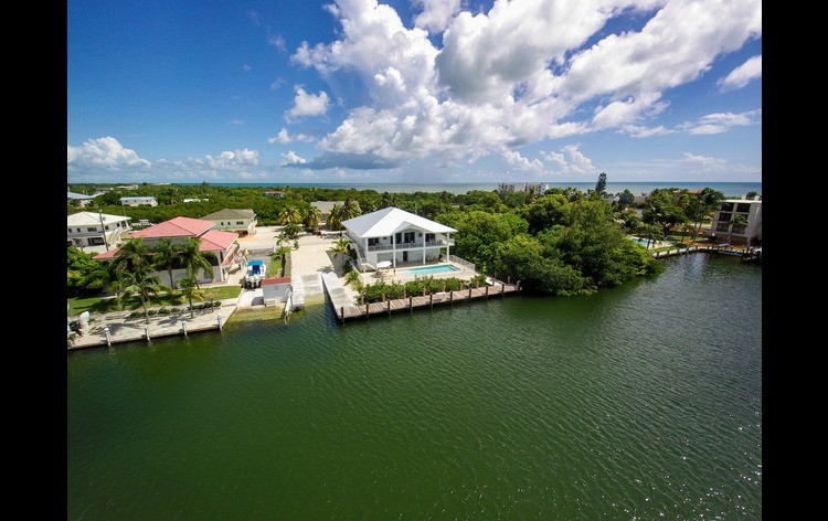 Aerial view of Grouper House, ramp and dock from Canal